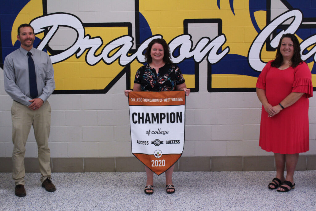 Pictured from left: CHS Head Principal Wyatt O'Neil, CHS Counselor Kelly Pettit and CHS Assistant Principal Rhonda Williams. Mrs. Pettit is holding a white and orange banner that reads2020 Champion of College Access and Success.